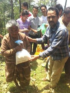 delivering rice to village woman photo: Ama Ghar
